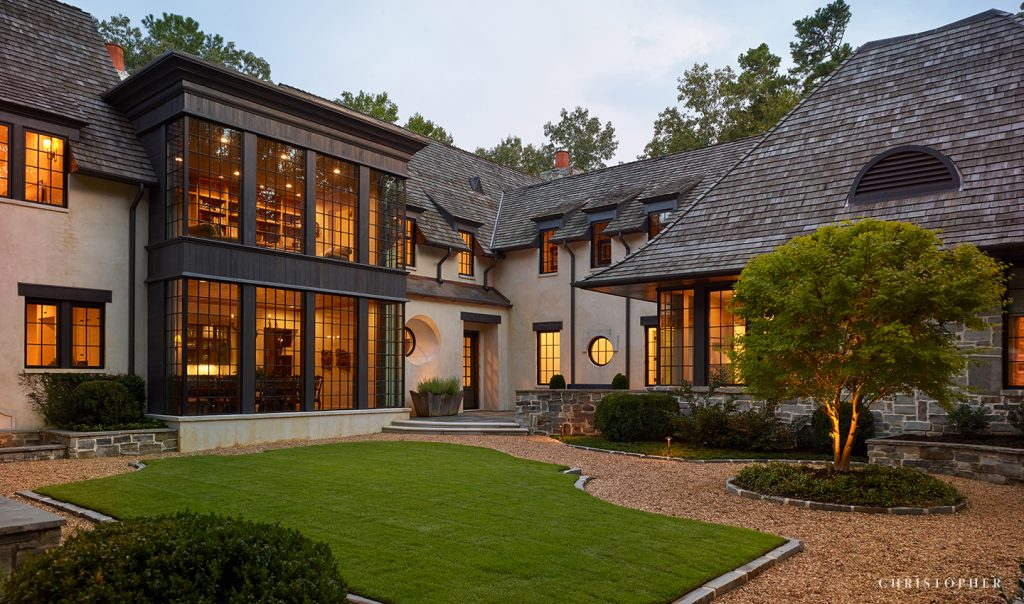 Light Filled French Normandy Courtyard Entrance with Two Story Windows