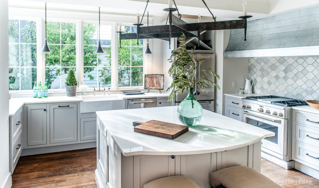 Spanish Colonial Light Filled Kitchen with Island and Wall to Wall Windows