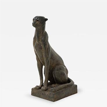 A contemporary bronze cheetah sculpture by sculptor Michel Lauricella