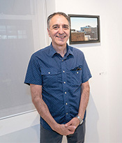 ASL Artist with cityscape painting Thumbnail