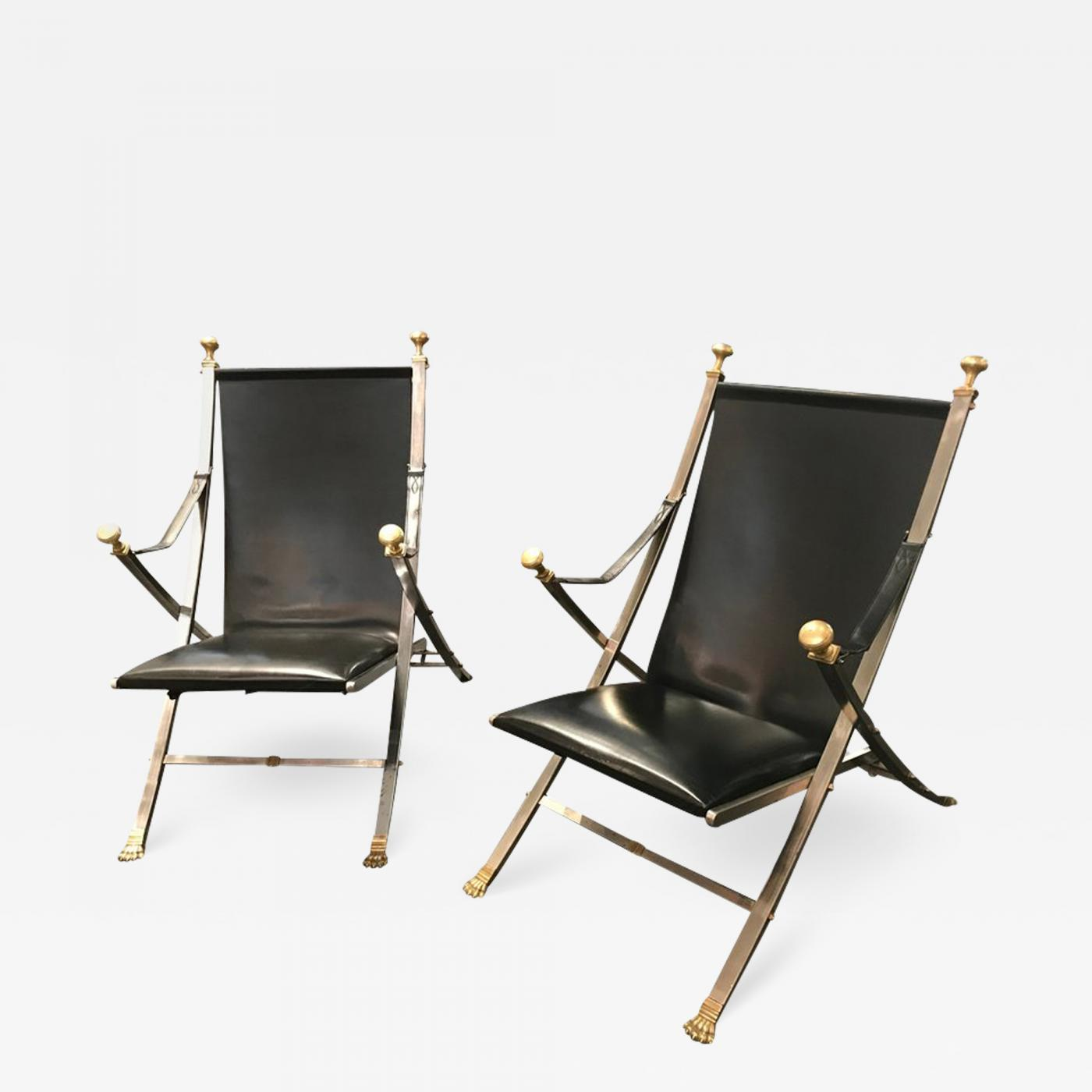 Pair of polished steel and leather folding chairs in the style of Maison Jansen