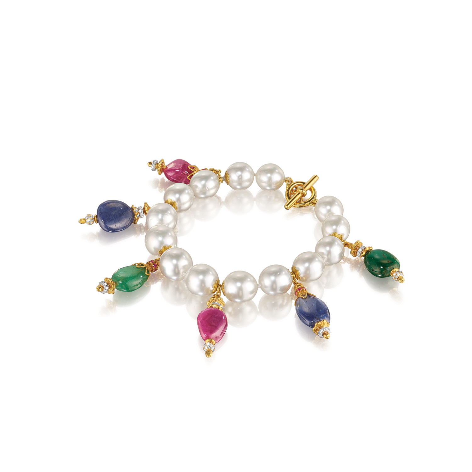 Inspired by the richly hued mosaics and gold-encrusted treasures of the Byzantine Empire, Verdura set gems into gold like tiles, mixing precious and semi-precious stones in various colors and cuts. South Sea cultured pearl, sapphire, emerald, ruby, diamond, gold and sterling silver